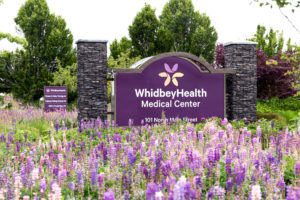 https://whidbeyhealth.org/wp-content/uploads/2021/09/Whidbey_Health_Sign_Flowers-LHP-scaled-300x200.jpg